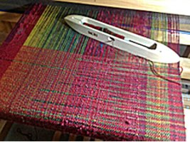 weaving on large floor loom