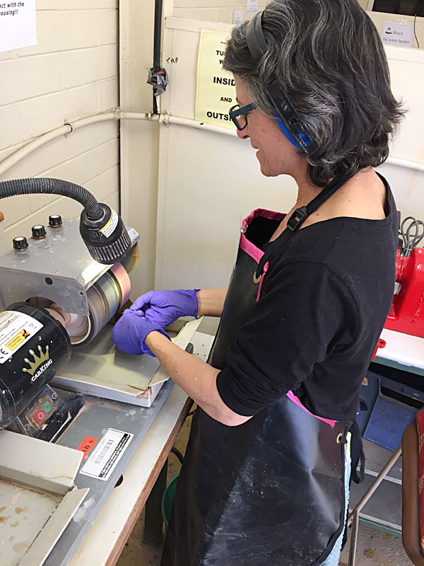 Fiona polishing some stones on the Lap Wheels